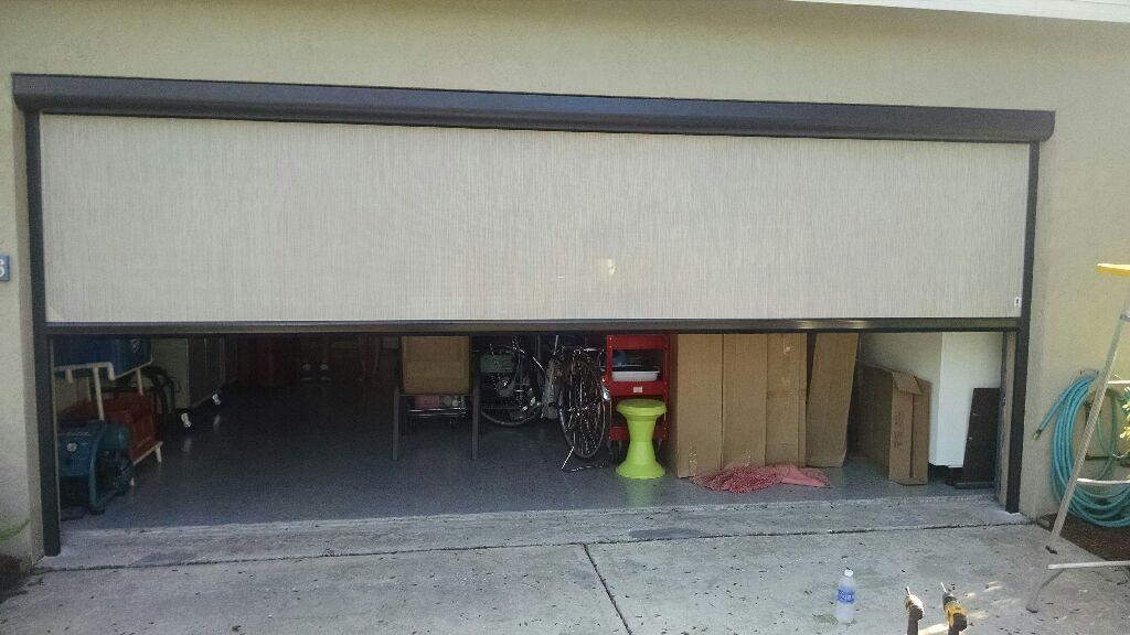 Garage Covering - Roman Shades, Roller Shades, Solar Shades, Cellular Shades, & more - Dynamic Delivery Blinds | Nashville, TN